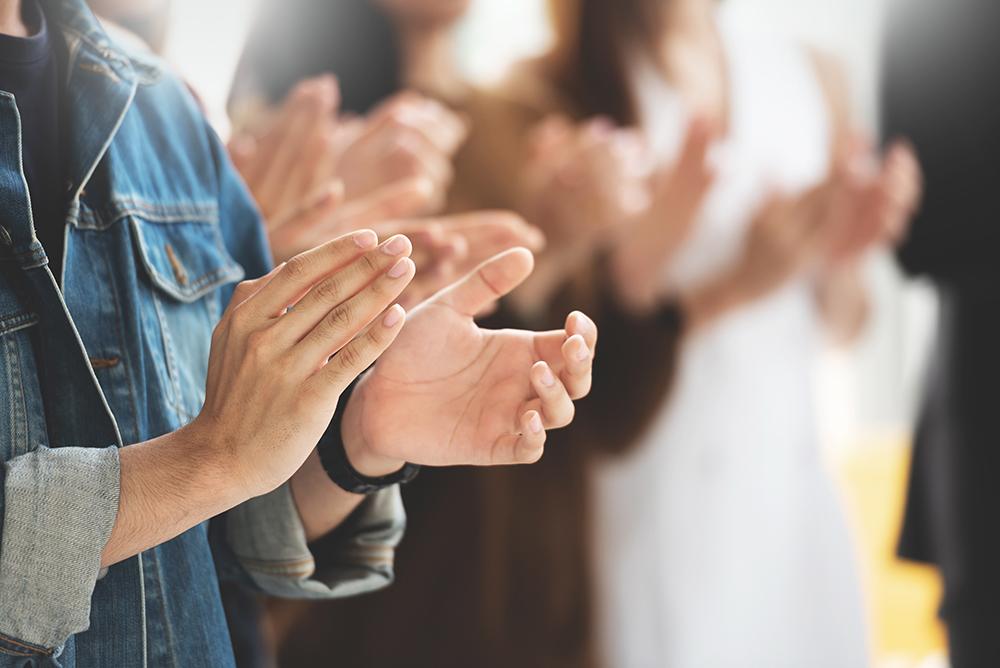 Applaudierende Personen